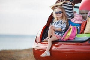 kid on summer vacation in the car