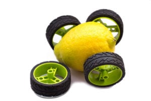 Lemon with toy wheels