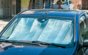 Sun reflector on the windshield of the car